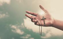 Praying Hands Hold A Crucifix ...