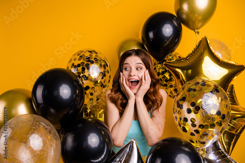 Photo of overjoyed lady yelling gladly surrounded by many balloons wear tank-top Wallpaper Mural