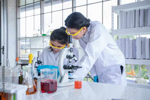 Fotografia  Medical Research and Scientists are working with a microscope and a tablet and Test Tubes, Micropipette and Analysis Results in a laboratory