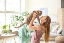 Beautiful Woman With Cute Cat At Home