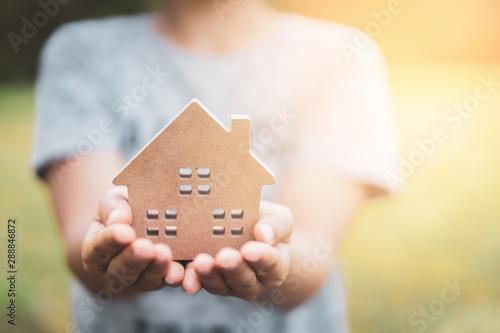 Vászonkép Small home model on woman hand.