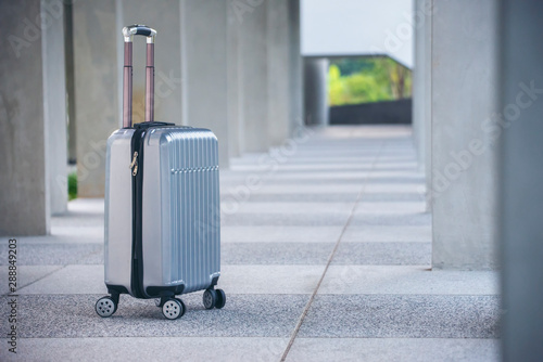 Obraz na plátně  Travel Gray Luggage or suitcase at airport