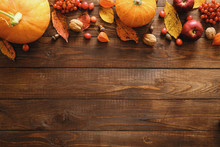 Autumn Frame Border Made Of Pumpkins, Dried Fall Leaves, Apples, Red Berries, Walnuts On Wooden Background. Thanksgiving, Halloween, Autumn Harvest Concept. Flat Lay Composition, Top View, Copy Space