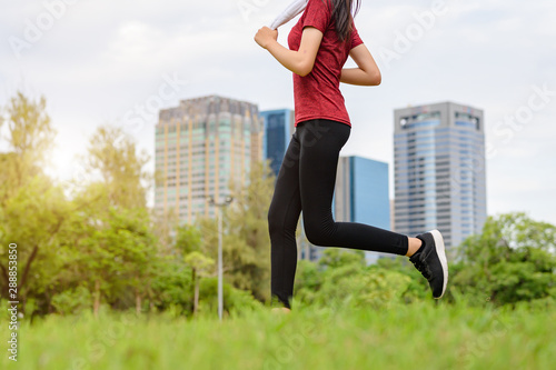 healthy woman jogging daily morning, exercise in city park alone Canvas Print