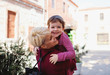 canvas print picture Mother with small daughter standing outdoors in mediterranean town.