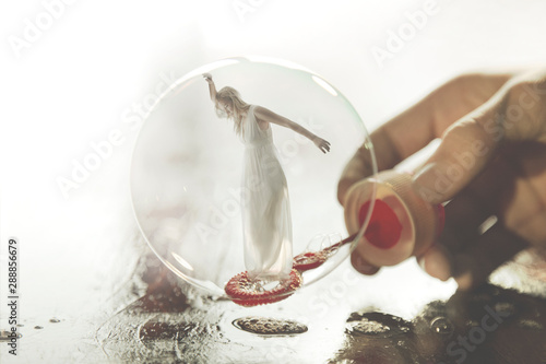 Fotografía surreal image of a woman imprisoned in a soap bubble