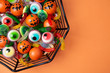 canvas print picture - Funny Haloween candy in a spiderweb bowl