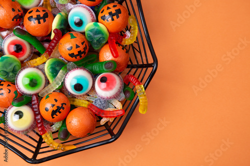 canvas print motiv - asife : Funny Haloween candy in a spiderweb bowl