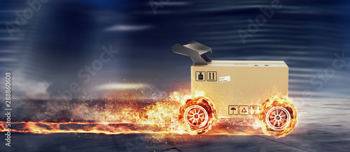 Priority Cardboard box with racing wheels on fire. Fast shipping by road. - fototapety na wymiar