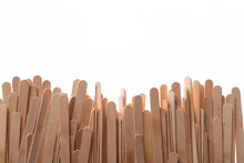 Many Wooden Ice Cream Sticks In Chaotically Row On White Background Isolated, Flat Lay Bottom