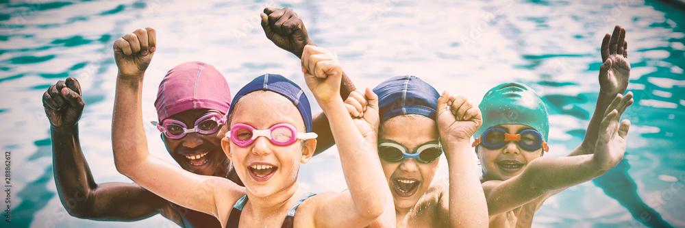 Fototapeta  Cheerful children enjoying at poolside
