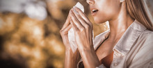 Beautiful Woman Using Tissue W...