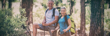 Couple Smiling And Posing During A Hike