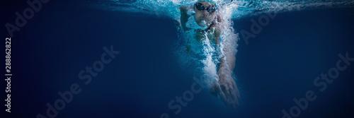 Obraz na plátně Fit swimmer training by himself