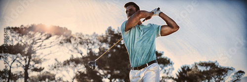 Full length of handsome golfer man taking shot