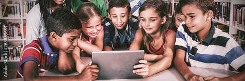 Front view of pupils using tablet pc
