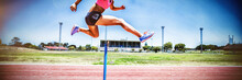 Female Athlete Jumping Above T...