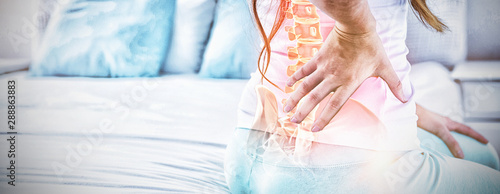 Fotografía Digital composite of highlighted spine of woman with back pain