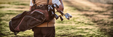 Man Carrying Golf Bag While St...