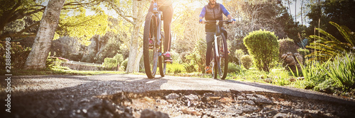Photo sur Aluminium Cyclisme Low angle view of biker couple cycling on countryside road