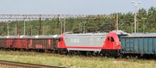 RAILWAY TRANSPORT - A Modern Locomotive Pulls Freight Wagons