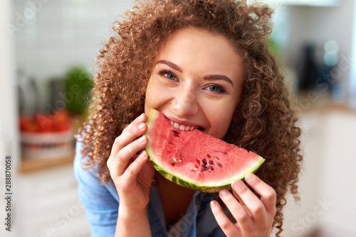 Beautiful woman eating a watermelon