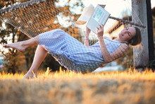 Beautiful Girl In Hammock Read...