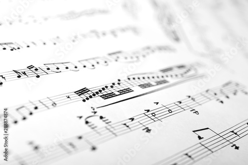 Sheets with musical notes closeup as a background - 288874874