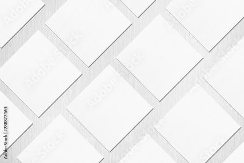Obraz na plátně Many empty white square business card mockups with soft shadows lying diagonally on neutral light grey textured background