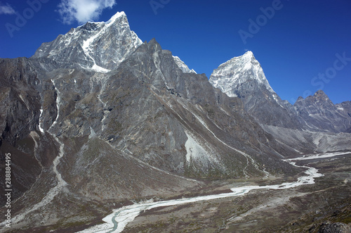 Vászonkép Tabuche peak (6367 m) and Arakam Tse (6423 m) in Himalayas mountains in the end