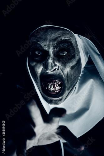 frightening evil nun with bloody teeth Wallpaper Mural