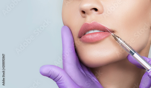 Cropped sensual female lips, procedure lip augmentation Poster Mural XXL