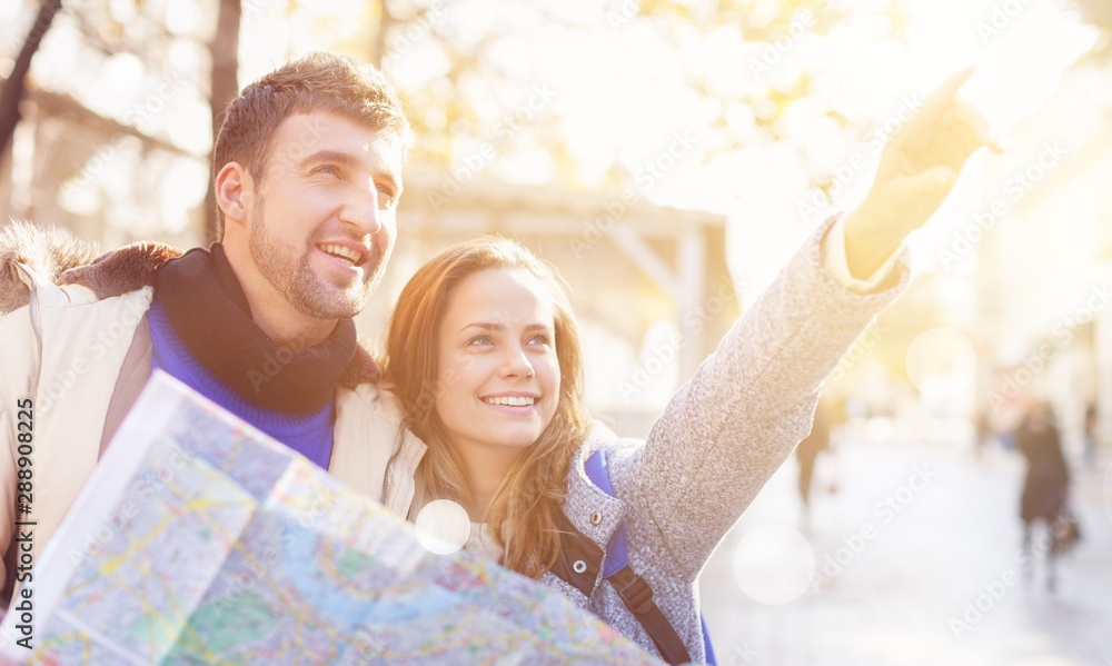 Fototapeta summer holidays, dating, city break and tourism concept - couple with camera and travellers guide