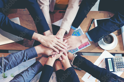 Fototapety, obrazy: Teamwork Success.  Top view executive business people group team happy showing teamwork and joining hands after meeting partner business in office. Business  Concept.