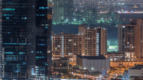 Foto auf Leinwand Blaue Nacht Jumeirah Lake Towers residential district aerial night timelapse near Dubai Marina