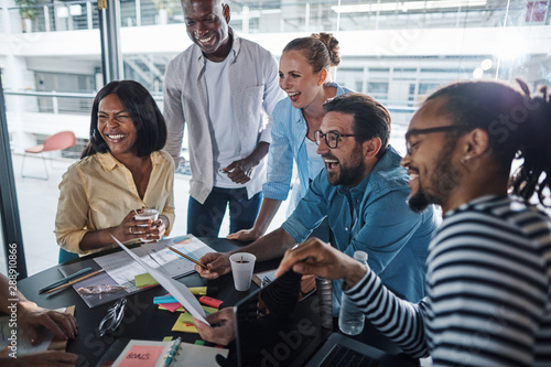Ingelijste posters Eigen foto Laughing group of diverse businesspeople having an office meetin