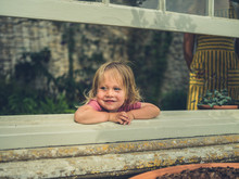 Little Toddler Looking Out The Window From Conservatory
