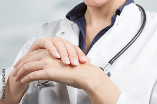 Fotografie, Obraz  young female doctor is applying protective hand cream