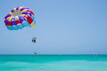 Colorful Parasail Wing Flying Over Turquoise Water Of Sargasso Sea, Punta Cana, Dominican Republic