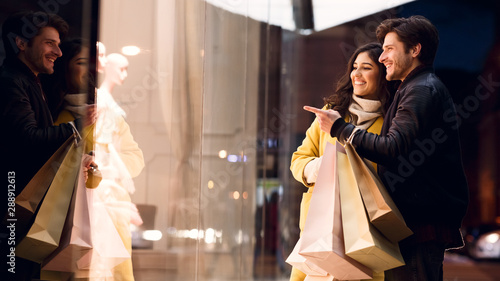 Couple looking at fashion store's window, shopping together Canvas Print