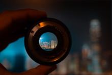 Hong Kong Night View Through Camera Lens. Photography And Travel Concept.
