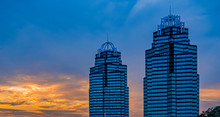Two Blue Glass Office Towers A...