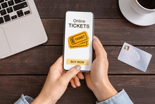 Application For Buying Tickets Online On Smartphone Screen In Female Hands