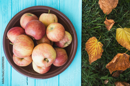juicy apples on a wooden background