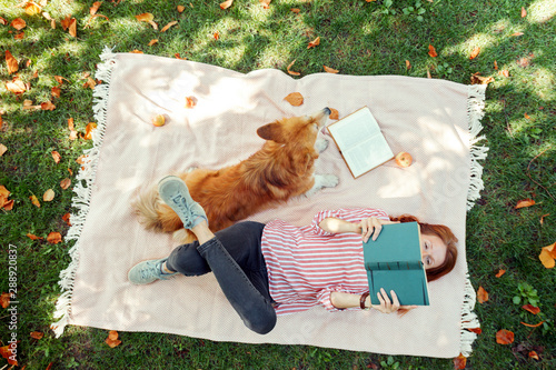 girl and dog on a lawn