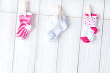 Baby Socks On Rope At Wooden B...