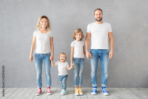 Obraz Happy family standing against grey background - fototapety do salonu