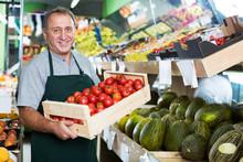 Man Seller Demonstraiting Red ...