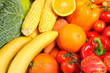 Ripe vegetables and fruits on whole background, close up