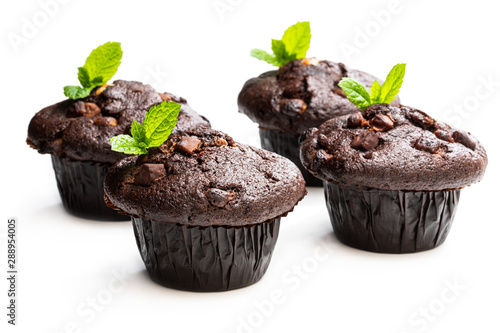 fototapeta na lodówkę Four chocolate muffins isolated on white decorated with mint leaves